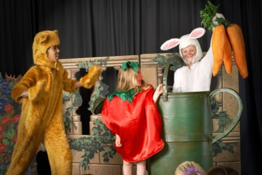 Stock Photo: 1527R-1082943 Three children (5-9) in food and animal costumes performing on stage