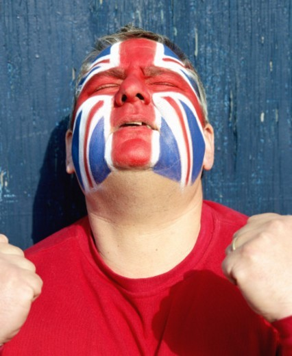 Stock Photo: 1527R-1083880 Soccer fan with face painted as Union flag, head tilted back
