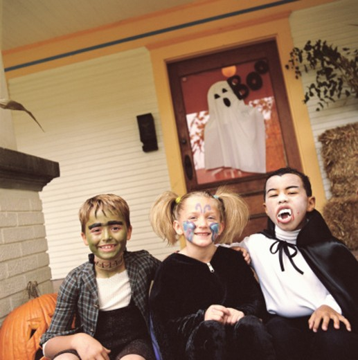 Three children (5-9) wearing Halloween costumes, portrait : Stock Photo