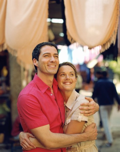 Couple embracing outdoors, smiling : Stock Photo