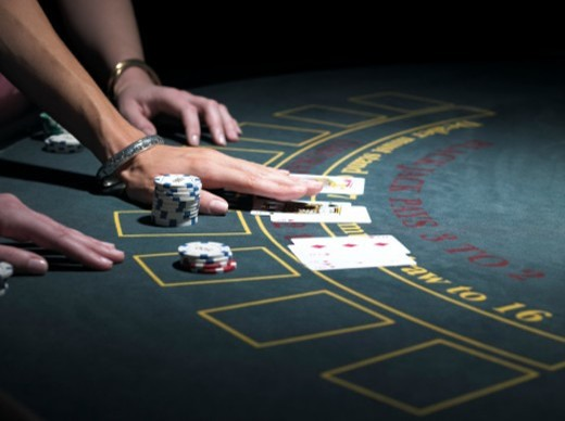 Two women playing Blackjack at gaming table, close-up : Stock Photo