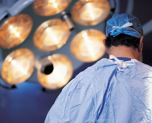 Rear View of a Surgeon : Stock Photo