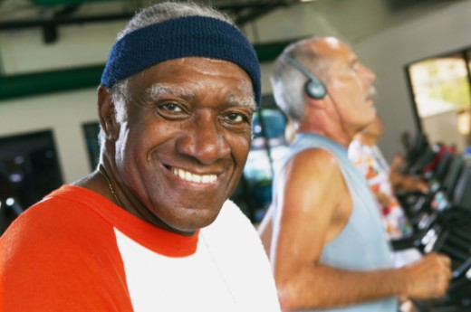 Senior man in gym, smiling, portrait, close-up : Stock Photo