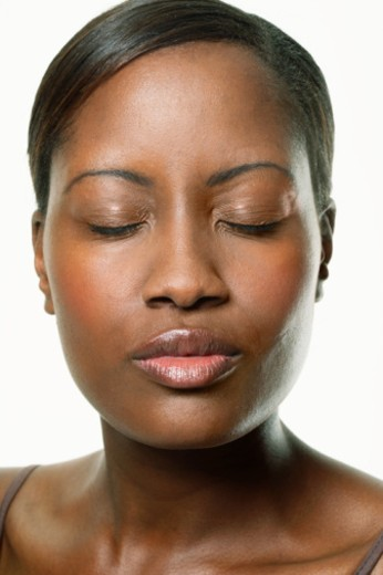 Young woman with eyes closed puckering lips, close-up : Stock Photo