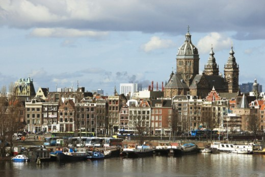 Stock Photo: 1527R-1095513 Holland, Amsterdam, St Nicholas church and skyline