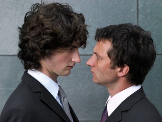 Two businessmen face to face, profile, close-up : Stock Photo