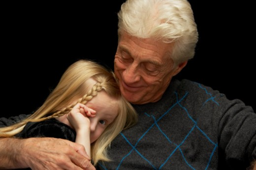 Stock Photo: 1527R-1099988 Grandfather embracing granddaughter (5-7) portrait, close-up