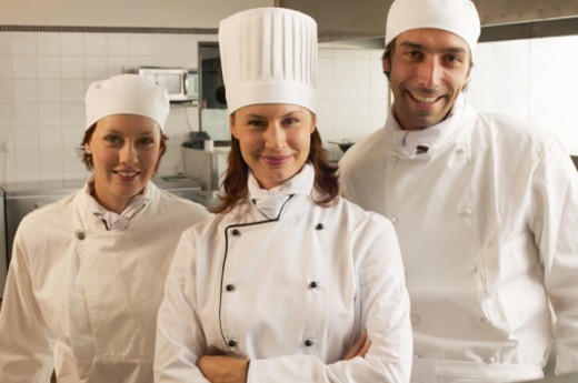 Stock Photo: 1527R-1100920 Female chef and two male and female cooks, smiling, portrait
