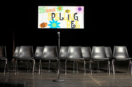 Stock Photo: 1527R-1105261 Chairs and microphone on empty stage, for spelling bee competition