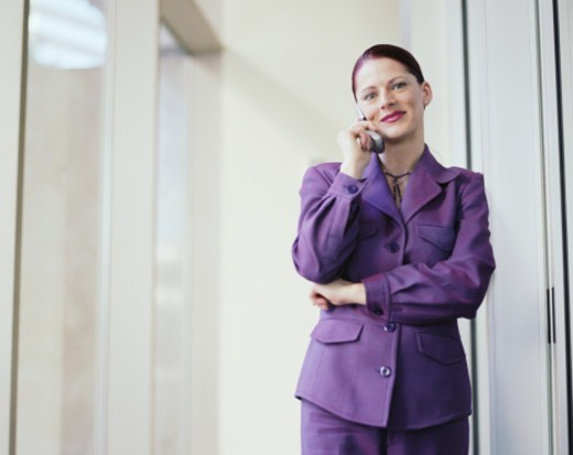 Stock Photo: 1527R-1110107 Woman talking on cell phone, smiling
