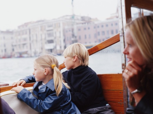 Italy, Venice, mother and children (7-10) on motorboat taxi : Stock Photo