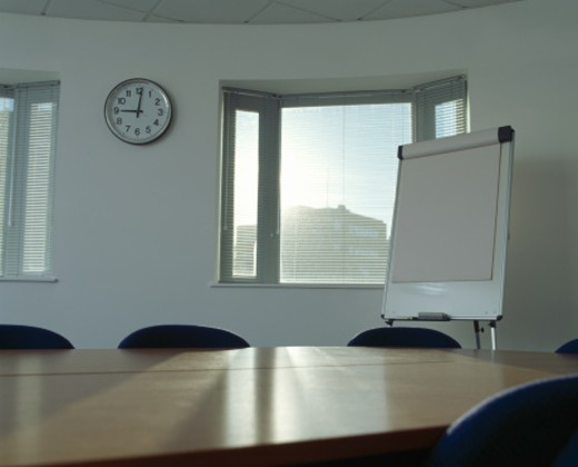 Sunlight shining through window of empty conference room : Stock Photo