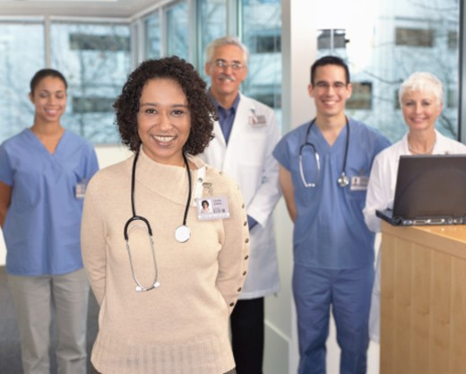 Medical professionals, portrait (focus on female nurse in foreground) : Stock Photo