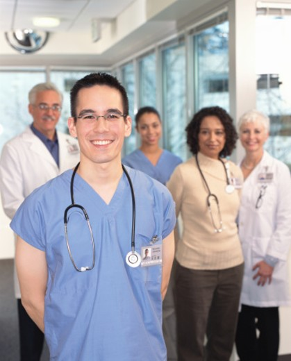 Stock Photo: 1527R-1113126 Medical professionals, portrait (focus on male surgeon in foreground)