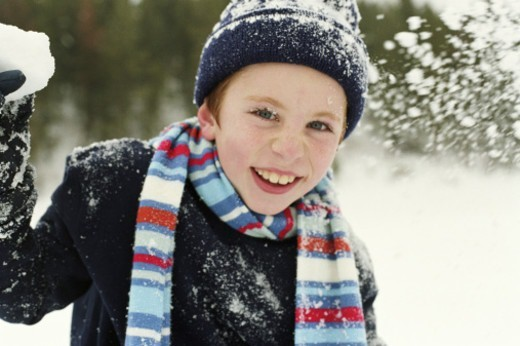 Boy (7-9) throwing snowball, portrait : Stock Photo