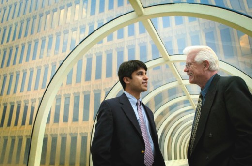Stock Photo: 1527R-1114118 Two businessmen talking in breezeway