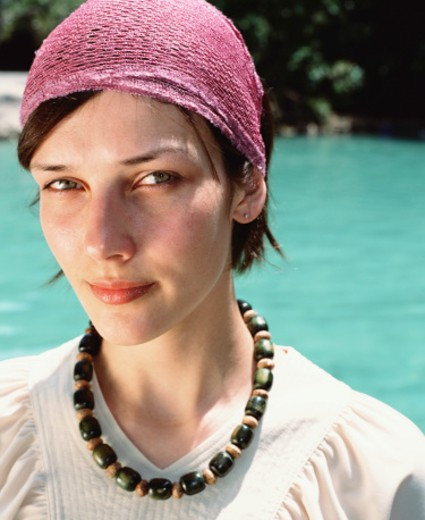 Young woman wearing headscarf and beads outdoors, portrait : Stock Photo
