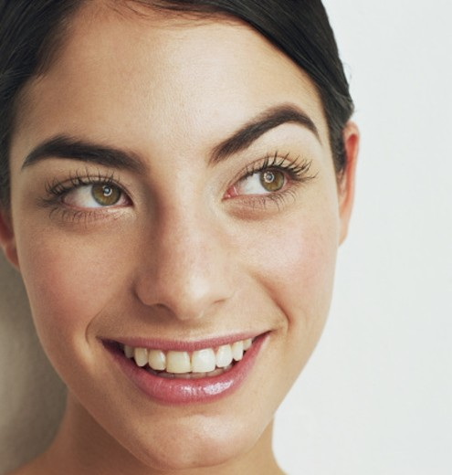Stock Photo: 1527R-1115753 Young woman smiling, close-up