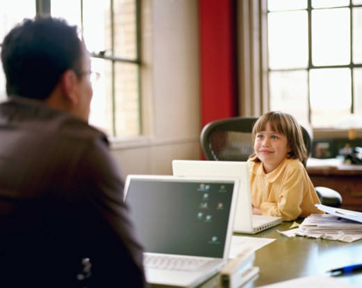 Father and daughter (4-6) using laptops in office (focus on girl) : Stock Photo