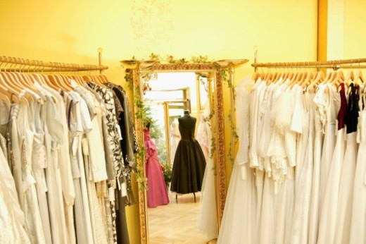 Stock Photo: 1527R-1117433 Dresses on hangers and mannequins in shop