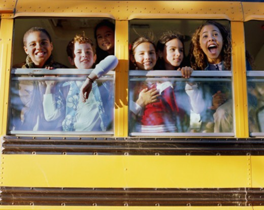 Stock Photo: 1527R-1118111 Six children (8-10) looking out windows on school bus, low angle view