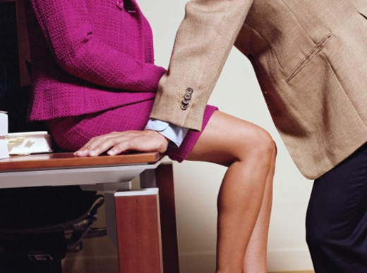 Stock Photo: 1527R-1120076 Businessman leaning over businesswoman, mid section