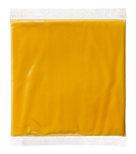 Hermetically sealed slice of american cheese : Stock Photo