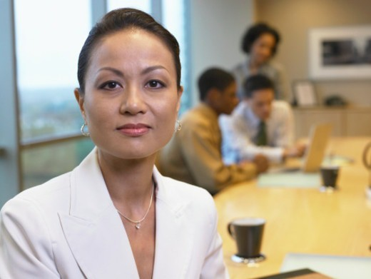 Businesswoman in conference room, portrait, close-up : Stock Photo