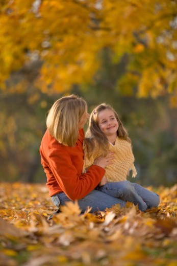 Mother holding daughter (5-7), Autumn : Stock Photo