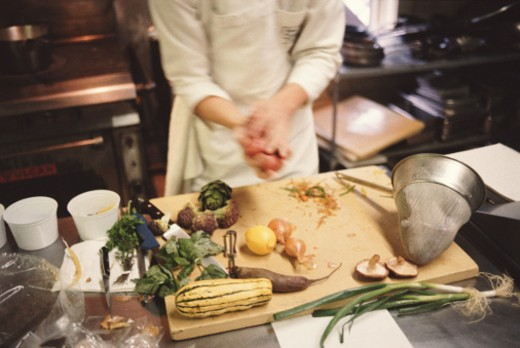 Chef prepares ingredients (blurred motion), low section : Stock Photo