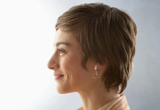 Stock Photo: 1527R-1131604 Woman smiling, side view