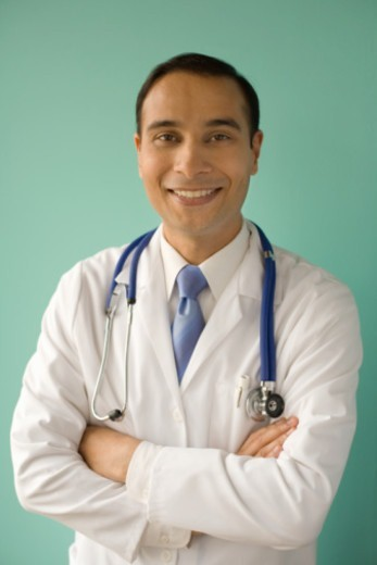 Doctor with arms crossed, portrait : Stock Photo