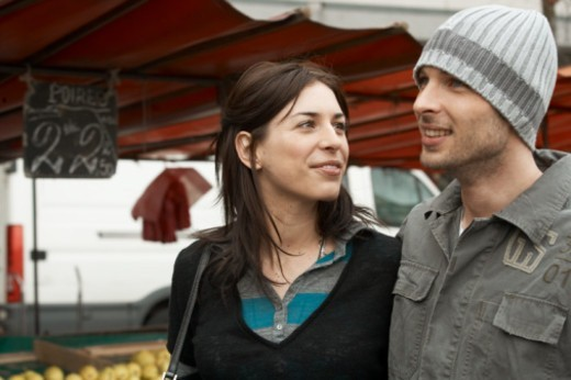 Couple walking in market, smiling : Stock Photo