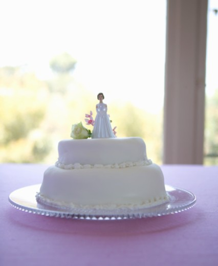 Wedding cake with bride on top : Stock Photo
