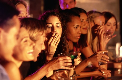 Young People Drinking at a Bar : Stock Photo
