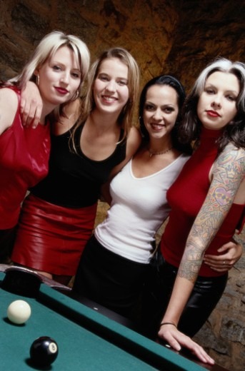 Friends By a Pool Table : Stock Photo