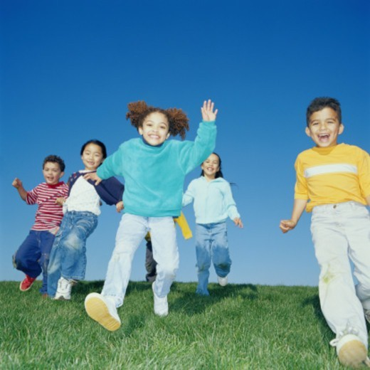 Stock Photo: 1527R-1144105 Group of Children Running and Playing