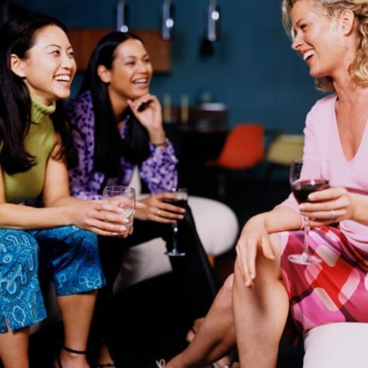 Three Women at a Social Gathering : Stock Photo