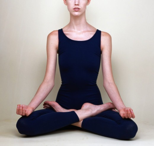 Woman in yoga lotus position : Stock Photo