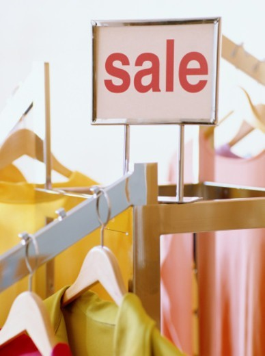 Sale sgn on clothes rack : Stock Photo