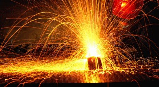 Worker welding with gas torch : Stock Photo