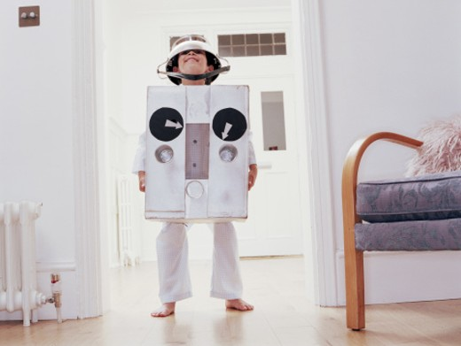 Stock Photo: 1527R-1150023 Boy (6-8) wearing robot costume