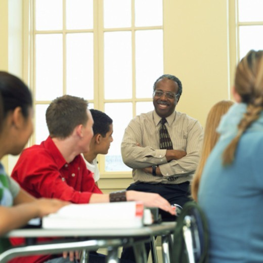 Teacher and students, high school classroom : Stock Photo