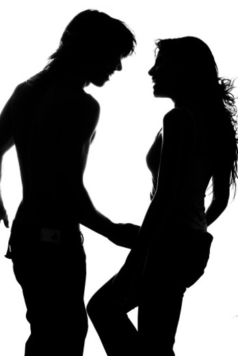 Silhouette of couple looking at each other : Stock Photo