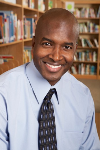 Stock Photo: 1527R-1159093 Teacher in school library, close-up, portrait