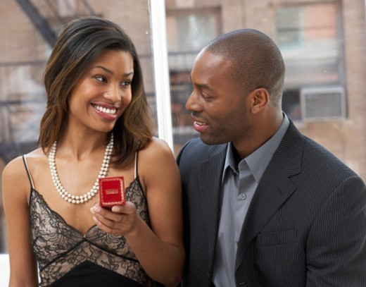 Couple sitting and smiling, close-up : Stock Photo