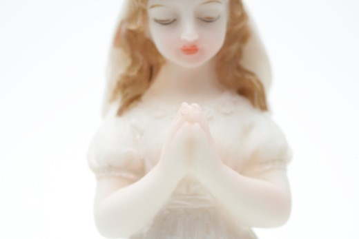 Stock Photo: 1527R-1163209 Girl porcelain doll in communion dress
