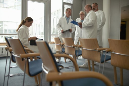 Group of doctors gathered in waiting room : Stock Photo