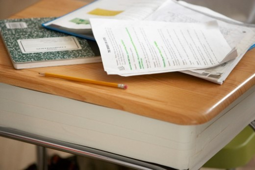 Stock Photo: 1527R-1166408 Notebook, book and papers on desk in classroom, close-up