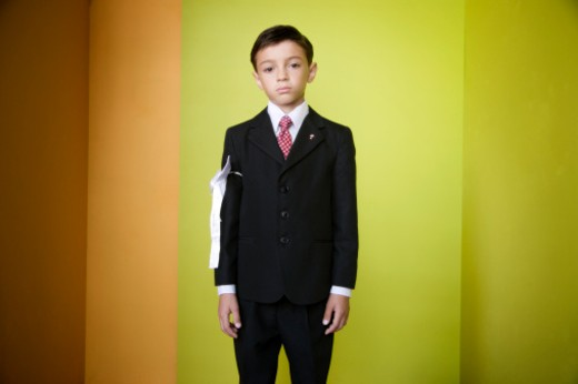 Stock Photo: 1527R-1168081 Portrait of boy (8-9) in suit, studio shot